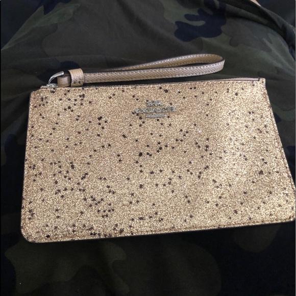 Coach Handbags - Coach WRISTLET WITH STAR GLITTER (COACH F38641)